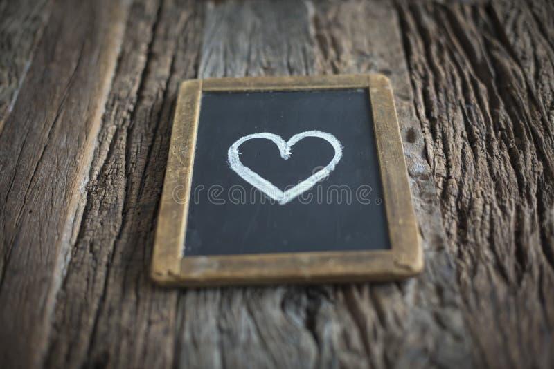 Sinal do amor no quadro imagens de stock royalty free