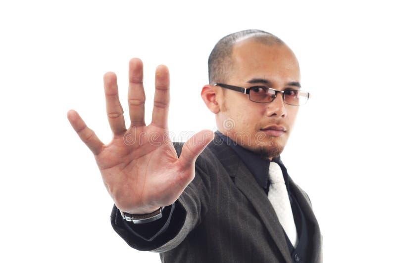 Sinal do batente da mostra do homem de negócio com sua palma imagens de stock
