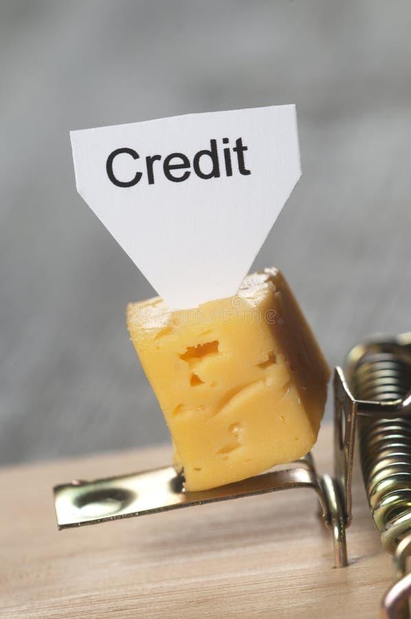 Sinal do ` do crédito do ` em um queijo na armadilha do rato foto de stock royalty free