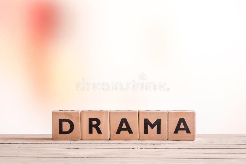 Sinal do drama em uma tabela fotos de stock