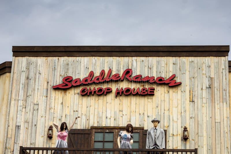 Sinal do restaurante da casa da costeleta do rancho da sela imagens de stock
