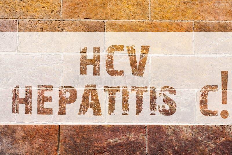 Sinal do texto que mostra a hepatite C de Hcv A infecção hepática conceptual da foto causou por uma parede de tijolo crônica seve imagens de stock royalty free
