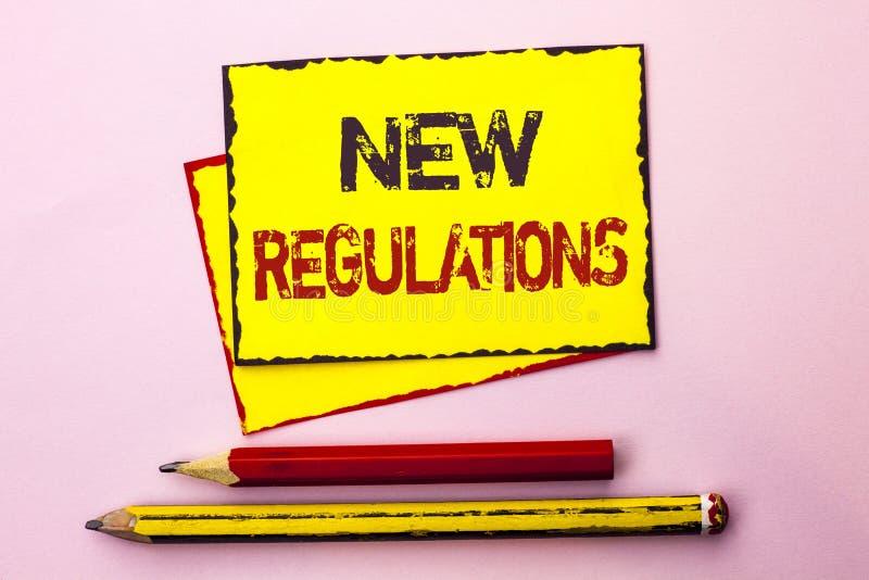 Sinal do texto que mostra regulamentos novos A mudança conceptual da foto das leis ordena as especificações de padrões incorporad fotos de stock royalty free