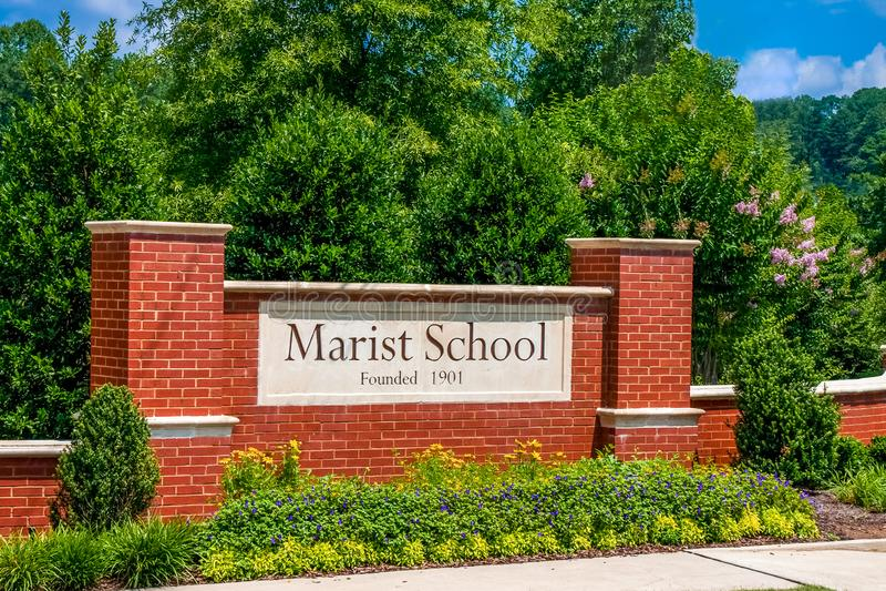 Sinal do tijolo da escola de Marist fotografia de stock royalty free