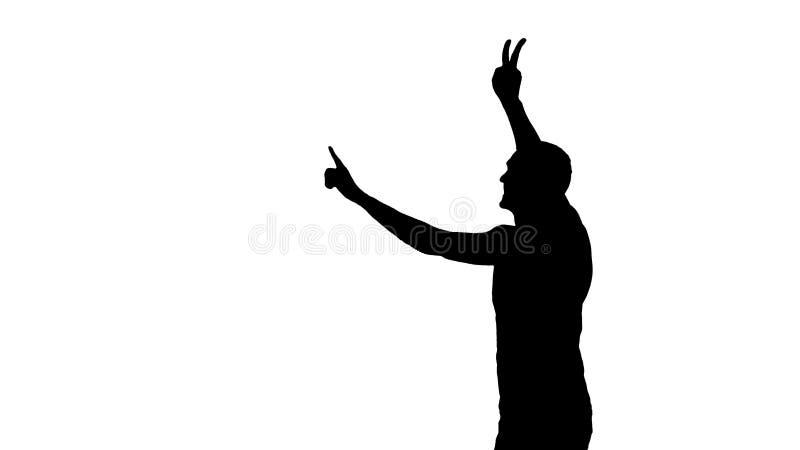 Sinal irreconhecível da vitória da exibição da silhueta do homem no fundo branco imagens de stock