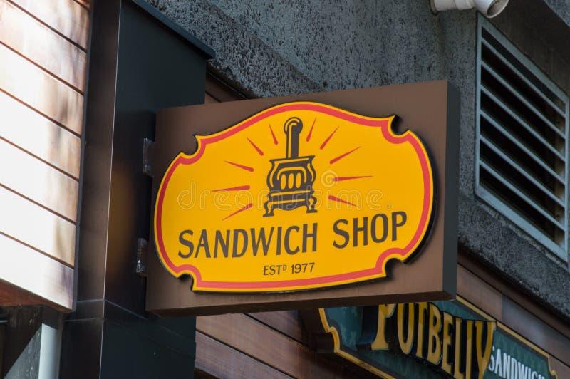 Sinal velho da loja do sanduíche fotos de stock