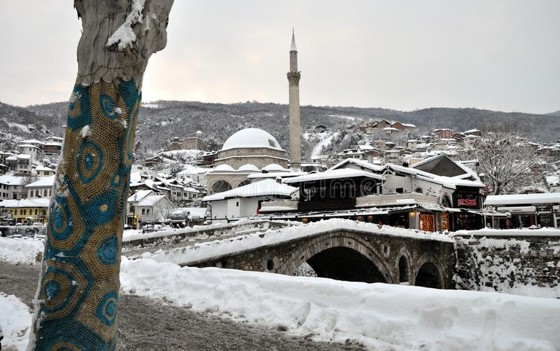 Sinan Pasha Mosque and Stone bridge covered with snow, Kosovo stock photography