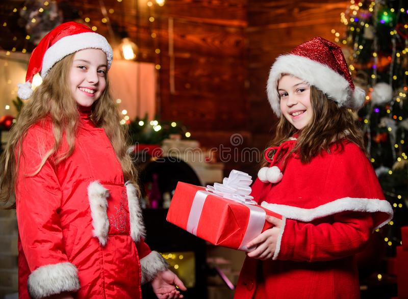 Sincere congratulations. Little girl sisters in hats. We are family. Elf children. Xmas gift. Santa little girls sisters stock image