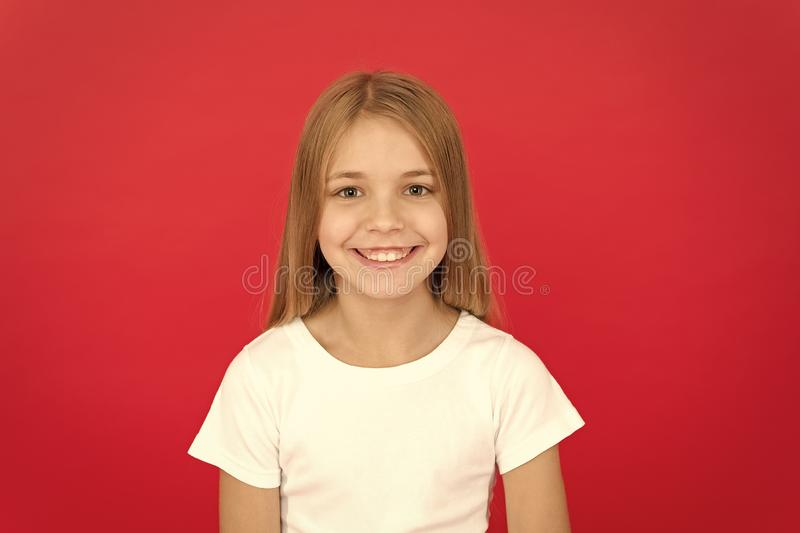 Sincere emotions. Brilliant smile concept. Girl happy smiling face over red background. Emotional kid joyful smiling stock photo