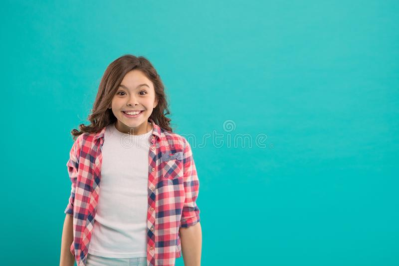 Sincere excitement. Kid girl long healthy shiny hair wear casual clothes. Exciting moments. Little girl excited happy stock photography
