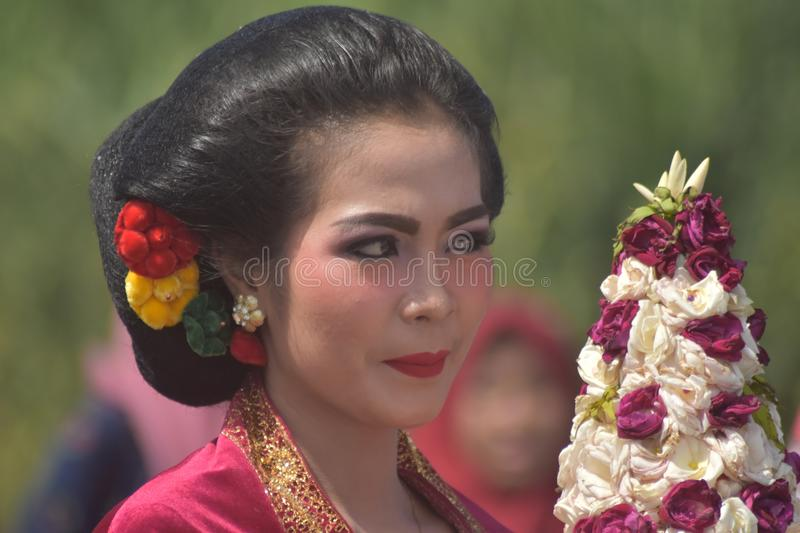 Javanese Girl. A Sincere Smile is a Symbol of Human Friendliness stock image