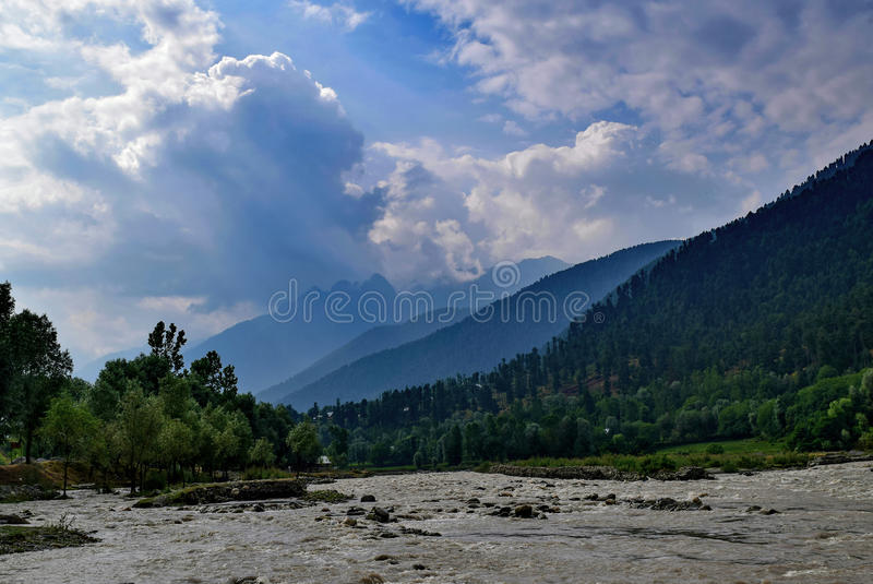 Sindhu river valley during morning near Sonmarg Kashmir. Captivating beauty of sindhu river valley near Sonmarg Kashmir. River runs along national Highway stock photo