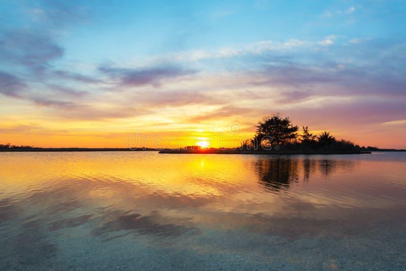 Sinepuxent Bay sunset at Assateague Island stock photo
