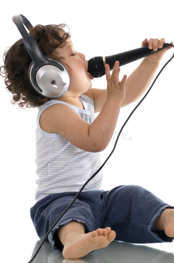 Sing baby. Sing baby with headphone and microphone,isolated on a white background