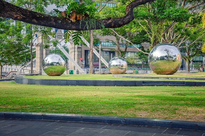 Singapore's life reflection in 24 Hours in steel spheres stock photography