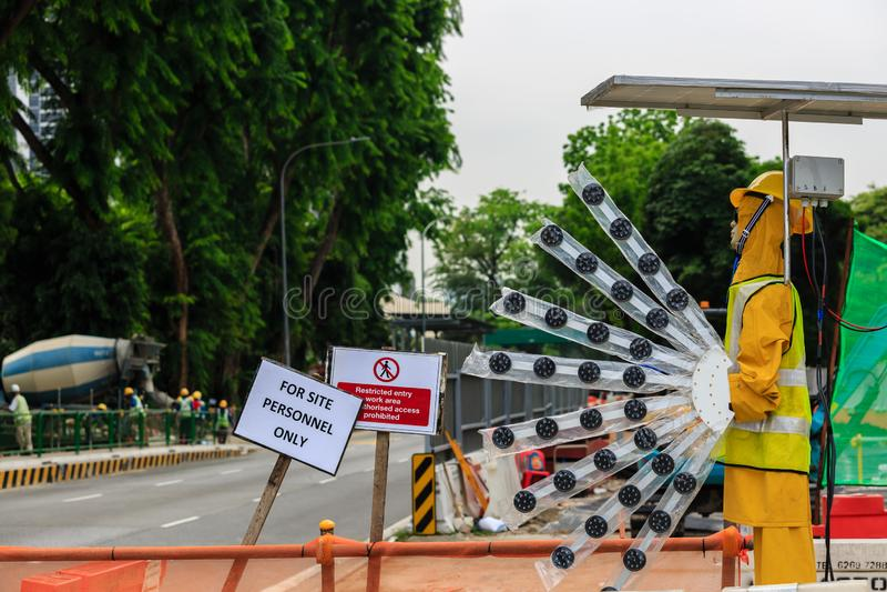 Singapore-02 APR 2019:yellow dummy warning on the construction site. Singapore-02 APR 2019:yellow color dummy warning on the construction site royalty free stock photo