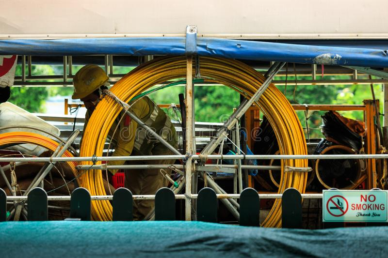 Singapore-02 APR 2019:indian worker hard working on construction truck. Singapore-02 APR 2019:indian worker working on construction truck stock image