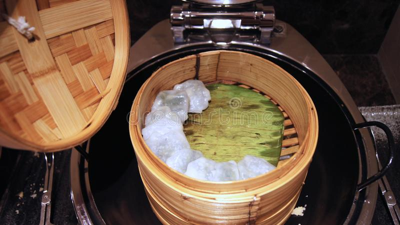 SINGAPORE - APR 2nd 2015: dim sum in bamboo steamer in a Executive Lounge at a luxury hotel, chinese cuisine.  stock images