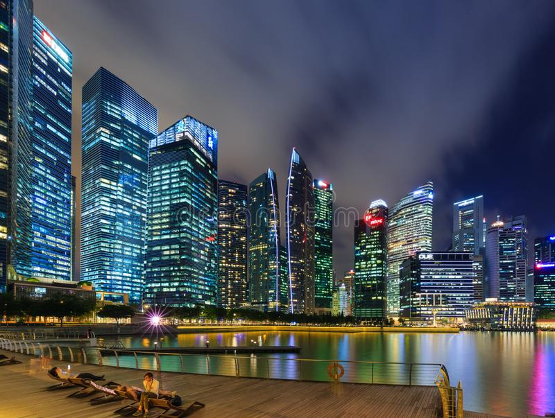 Singapore-30 APR 2018: Singapore`s Central Business District, seen from across Marina Bay. At night with water reflection royalty free stock photography
