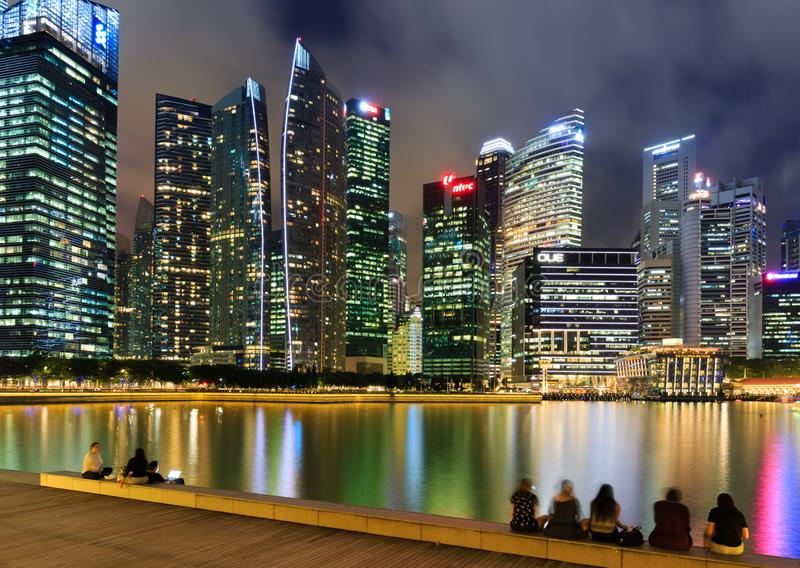 Singapore-30 APR 2018: Singapore`s Central Business District, seen from across Marina Bay. At night with water reflection royalty free stock photo