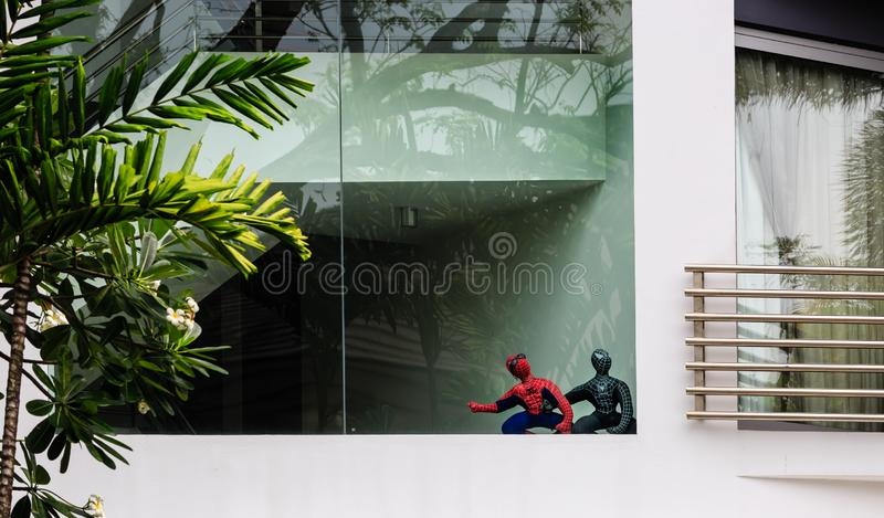 Singapore-02 APR 2019:two spider man toy display on the big window. Singapore-02 APR 2019:spider man toy display on the big window stock photo