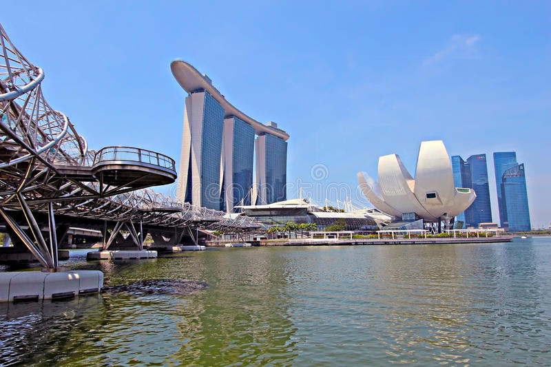 Singapore ArtScience Museum, Double Helix Bridge and Marina Bay. SINGAPORE - APRIL 23: Marina Bay Sands is billed as the world's most expensive standalone casino royalty free stock photo