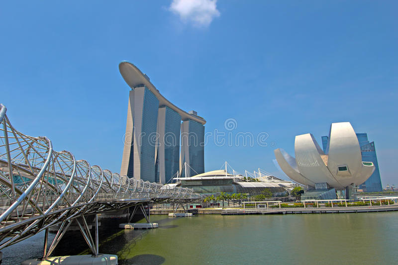 Singapore ArtScience Museum, Double Helix Bridge and Marina Bay. SINGAPORE - APRIL 23: Marina Bay Sands is billed as the world's most expensive standalone casino royalty free stock photos