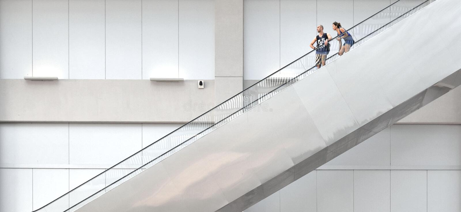Singapore The atrium of Centrepoint Shopping Mall in Marina bay Sands with people on stairs elevator with backgr royalty free stock photo