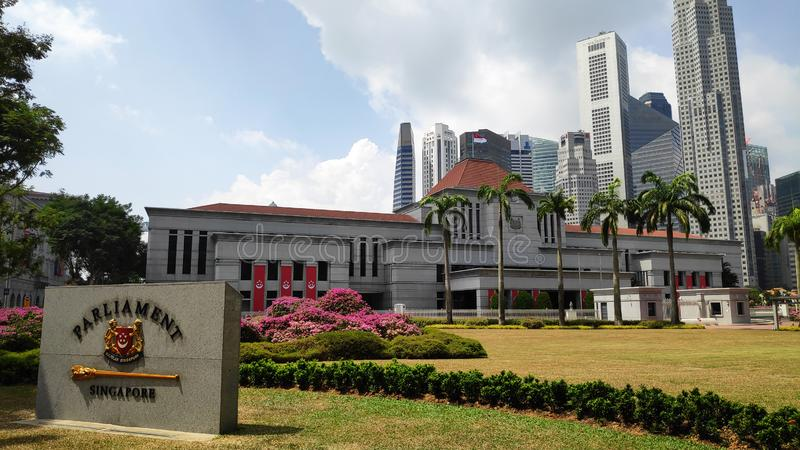 Parliament of Singapore and marble plate with city skyline in background stock photos