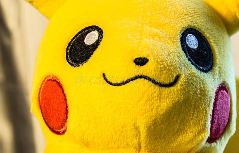 Singapore-AUG 2 2017:soft toy pikachu smile face closeup background royalty free stock image