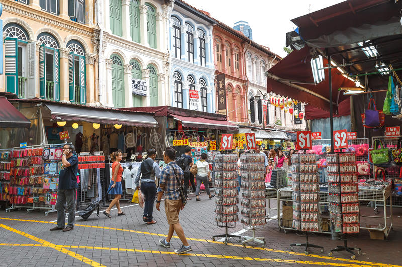 SINGAPORE - AUGUST 8, 2014 Shoppers walk through Chinatown as Singapore welcomes in Singapore. The city state`s ethnic Chinese beg stock photo