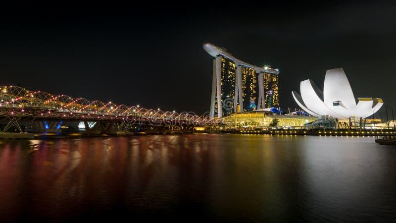 Singapore Bay at night with illuminated helix bridge royalty free stock photo