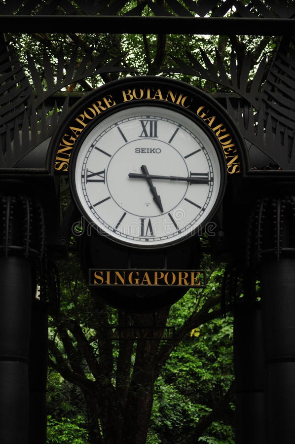 Singapore Botanical Gardens entrance and landmark clock. Singapore Botanical Gardens clock and landmark time royalty free stock photos