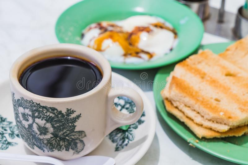 Singapore Breakfast Kaya Toast, Coffee bread and Half-boiled egg. Singapore Breakfast called Kaya Toast, Coffee bread and Half-boiled eggs, Chinese coffee in royalty free stock images