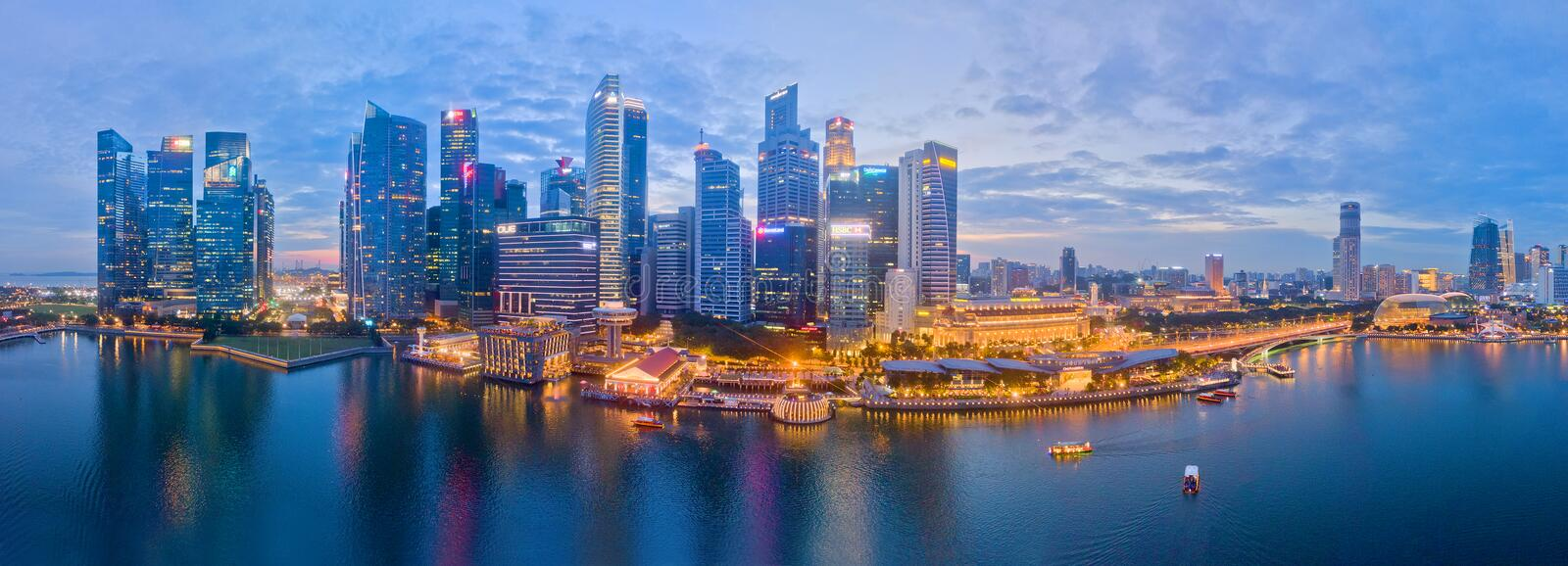 Singapore Business District Aerial View. Singapore business district, financial hub at Shenton Way. evening aerial view during blue hours from Marina Bay stock photo