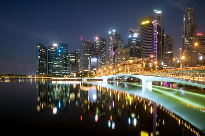 Singapore business district skyline financial downtown building with tourist sightseeing in night at Marina Bay, Singapore. Asian. Tourism, modern city life, or stock photography