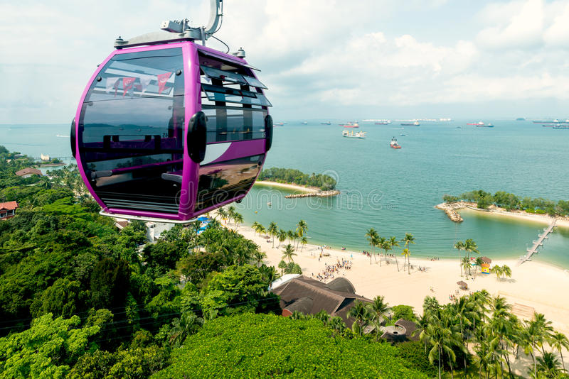 Singapore cable car in Sentosa island with aerial view. Singapore cable car in Sentosa island with aerial view of Sentosa island in Singapore royalty free stock photography