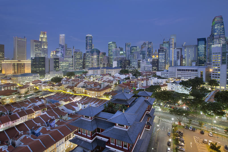 Singapore Central Business District Over Chinatown Blue Hour. Singapore City Central Business District (CBD) Over Chinatown Area with Old Houses and Chinese stock photos