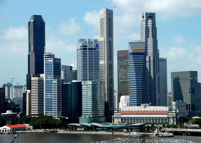 Singapore: Central Business District Skyline. The soaring skyscraper towers of the Central Business District with the renowned Fullerton Hotel at lower right stock images