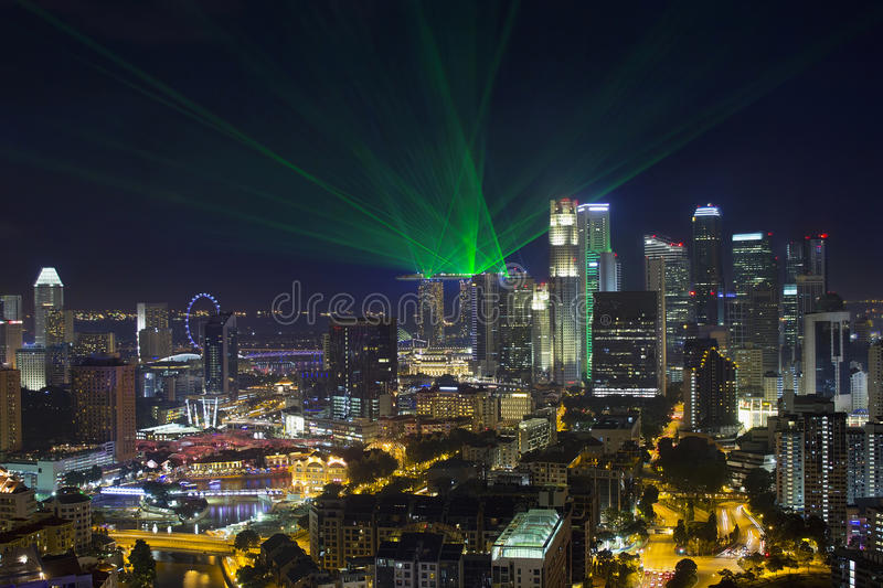 Singapore Central Business District Skyline. And Laser Light Show at Blue Hour Evening royalty free stock photo