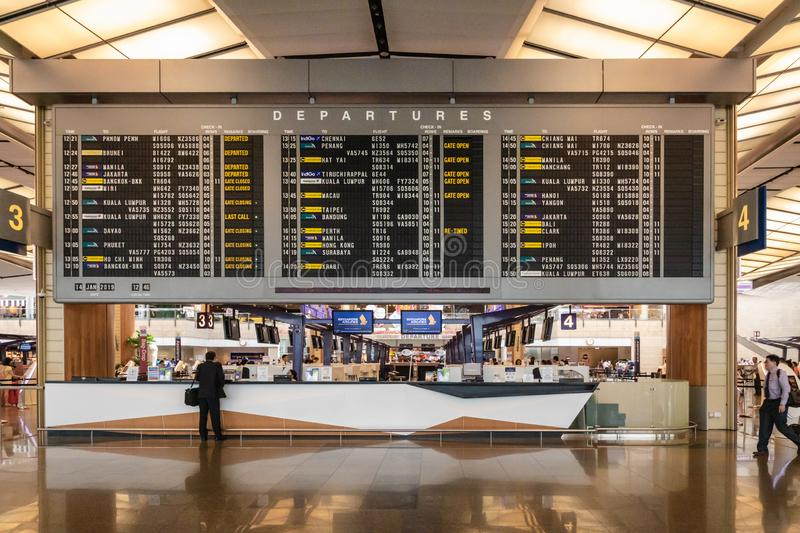 Singapore Changi Airport terminal with big departure schedule display. stock image