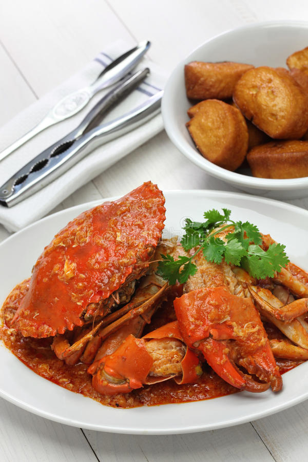 Singapore chili crab. Chilli mud crab with fried mantou, singapore cuisine royalty free stock image