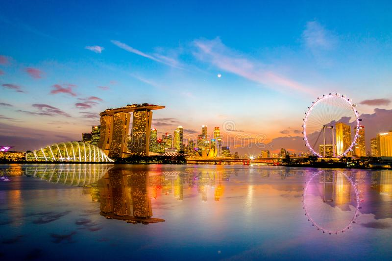 SINGAPORE CITY, SINGAPORE: Dec 12,2017: Singapore Skyline. Singapore`s business district, marina bay sand and the garden by the b. Ay on sunset stock image