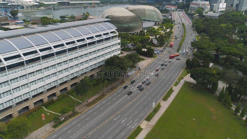 Singapore - 25 September 2018: Singapore city skyline along Singapore River, beautiful green grass and the road. Shot stock photo