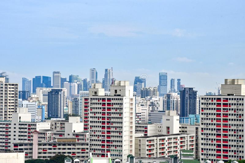 Singapore Cityscape : Public and Private Properties. Singapore cityscape consisting of public housing blocks in the foreground and commercial skyscrapers in the royalty free stock photography