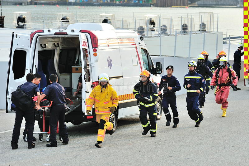 Singapore Civil Defense Force (SCDF) personnel demonstrating emergency responses during National Day Parade (NDP) Rehearsal 2013 stock photo