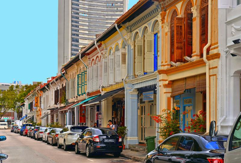Colonial house with cars parked and people in Little India in Singapore. Little India is an ethnic neighbour stock image