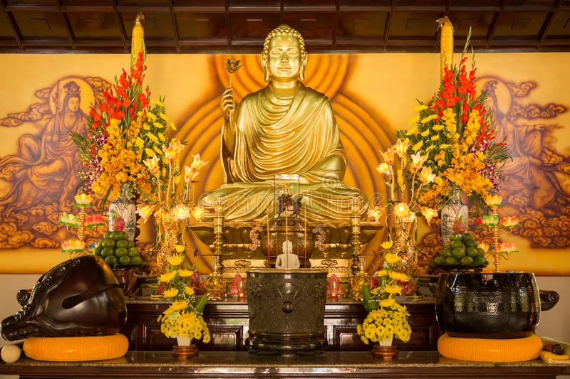 SINGAPORE/SINGAPORE - 23 DEC, 2015: Statue of Buddha sitting in meditation and waiting for Nirvana with hands in ritual gesture. I. Nside the Buddha Tooth Relic royalty free stock photography