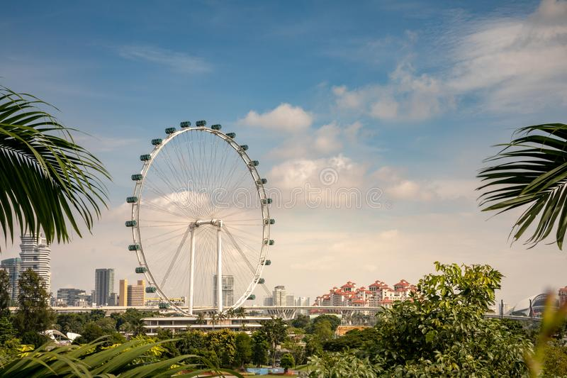 Singapore - december 2018: Singapore Flyer, the Largest Ferris Wheel in the World, seen from the Gardens by the Bay. Singapore Flyer is the Largest Ferris Wheel stock photos