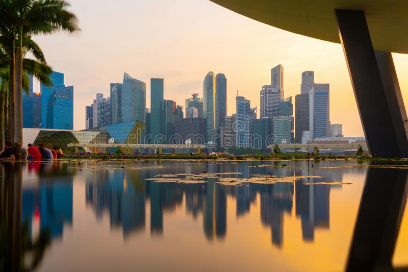 Singapore Downtown skyline at sunset with reflection. Financial district and business centers in technology smart urban city in. Asia. Skyscraper and high-rise royalty free stock images